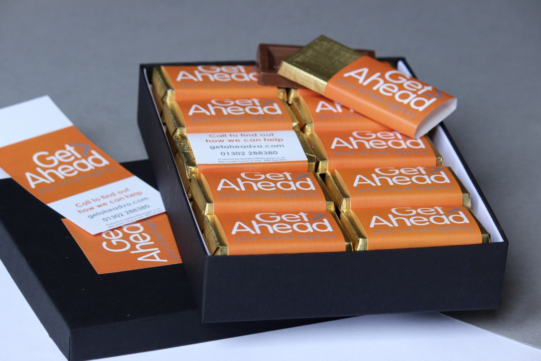 Corporate chocolate bars with a company logo on the wrapper